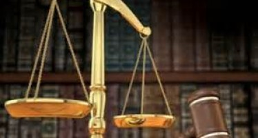 MAN ARRAIGNED FOR BURYING CHARMS CLOSE TO NEIGHBOUR'S HOUSE