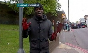 Michael Adebolajo speaks to a person holding a smartphone after killing Lee Rigby in Woolwich