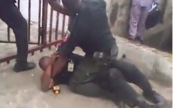 WATCH VIDEO OF TWO DRUNK POLICEMEN FIGHTING IN FRONT OF A BANK
