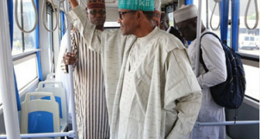 BUHARI PICTURED ON AIRPORT SHUTTLE BUS