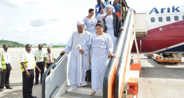 (PHOTOS) ALAAFIN LANDS IN ABUJA WITH WIVES FOR SON'S INAUGURATION AS FEDERAL LAWMAKER