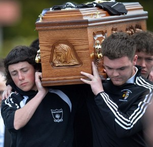 Pacemaker Press 9/6/2015  Family and Friend during the funeral of 17 year old Ronan Hughes at St Patrick's Church  in Clonoe Co Tyrone ,  The  schoolboy understood to have taken his own life after being tricked into posting images online. Pic Colm Lenaghan/Pacemaker