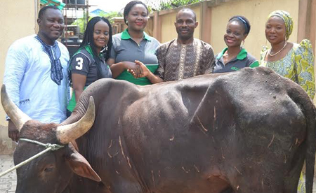 OrijoReporter.com Presentation of a cow to the winner of Heritage Bank Mobile Christmas give away