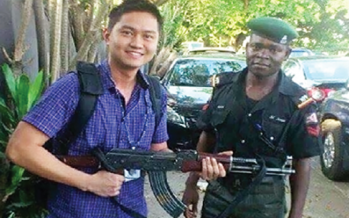 PICTURE OF FOREIGNER POSING WITH POLICEMAN'S GUN CAUSED OUTRAGE