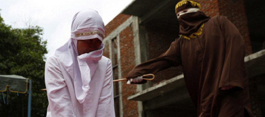 Woman Caned in Public for Adultery
