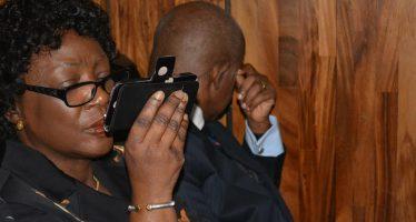 Justice Ademola tries to hide face during court appearance with wife