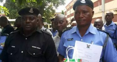 Two policemen, who returned N5m they found to owner promoted
