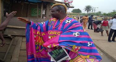 Barca fan wears  Agbada made of club colour