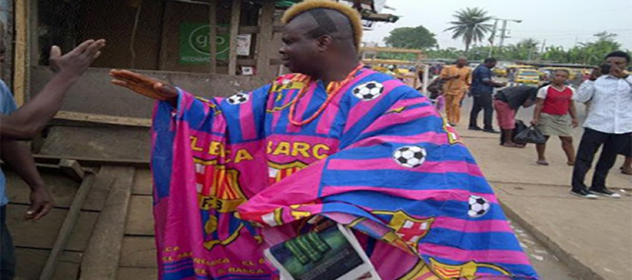 Barca fan wears  Agbada made of club colour