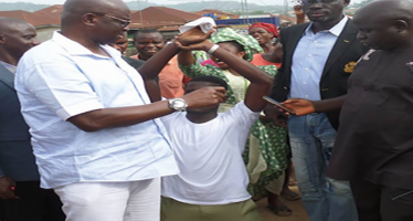 (Photos) Fayose gives corper automatic employment for hailing him