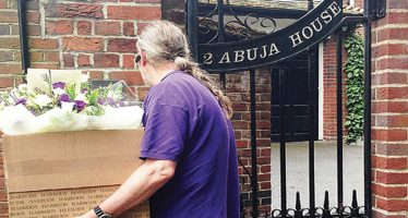 Well-wisher delivers flowers to Buhari in London